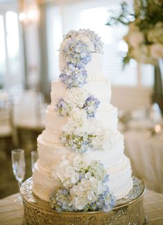 white wedding cake with light blue hydrangeas