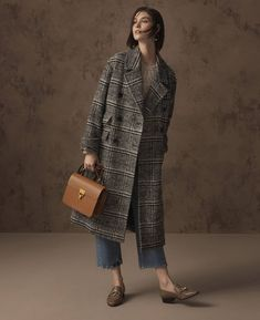 Limited edition coat, £99, Autograph jumper, £49.50, M&S Collection jeans, £45, earrings, £9.50, bag, £29.50, shoes, £65.