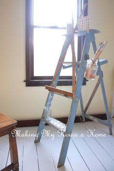 A Ladder Turned Easel | makingmyhouseahome