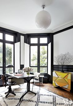 Painter's canvas is used as paneling in the home office of fashion designer Stefano Pilati's Paris apartment, which was renovated by architect Bruno Caron.