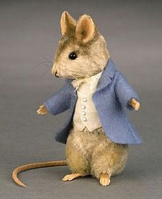 Johnny Town Mouse by R. John Wright.   Mr Wright is, and always has been, an uncredible sculptor in the fibre arts!
