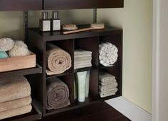 Lovely towel storage with our ShelfTrack Elite in Chocolate.