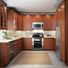 A modern kitchen with brown drawers, doors and glass doors.