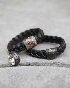 """Braided black leather, 14mm. Black bronze and sterling silver push clasp with woven chain texture. Pave black sapphire. 8 1/2""""L. Made in Thailand."""