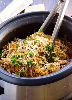 Easiest Slow Cooker Chicken and Spaghetti (GF option) - 10 minute prep, no pre-browning and a true 10 hour slow cooker recipe. Your family will be all over this dish or you.