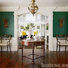 An emerald green foyer makes a striking first impression in this historic home. - Photo: Werner Straube / design: Corey Damen Jenkins