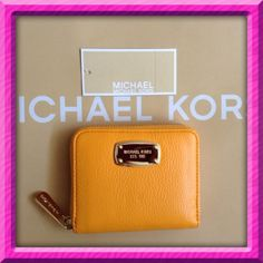 """Authentic Michael Kors Leather Zippy Wallet % AUTHENTIC ✨ This is soft leather bi fold wallet from Michael Kors  Color: Vintage Yellow  Yellow gold tone hardware  Very spacious  Lots of compartments for your cards, cash & coins Length 4 1/2"""" Height 3 3/4"""" Width 1"""" NO TRADE PRICE FIRM Michael Kors Bags Cosmetic Bags & Cases"""