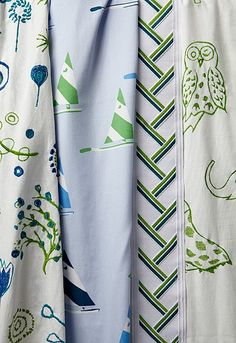 Schumacher kid's fabrics in green/blue.