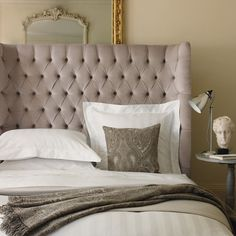 I love the curved, coccooning effect of this headboard.