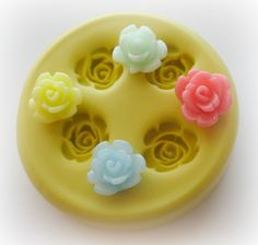 So tempted to try this: Rose Mold Flower Silicone Flexible Clay Resin Mould. $5.95, via Etsy.