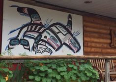 Exterior wall art of Orcas on Qualicum Trading Post, Coombs, BC