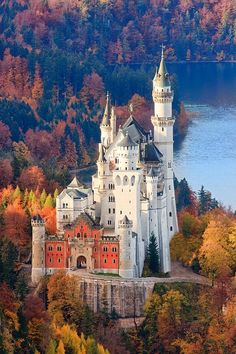 """Dream Destination of the Day : Neuschwanstein Castle in Bavaria, Germany. Is the height of fairy tale castles. In fact, it was build for Ludwig II of Bavaria in 1869 by a theatrical set designer, rather than an architect. The name means """"New Swan Stone,"""" after a Wagner opera.  It was also the inspiration for Disney's Sleeping Beauty Castle."""