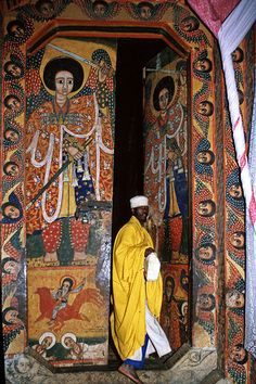 Church wall paintings - Tana lake    Priest leaving church at Tana lake - Ethiopia