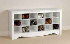 Idea for at the foot of the bed. just add doors and a cushion. White Shoe Storage Cubby Bench by Prepac $158