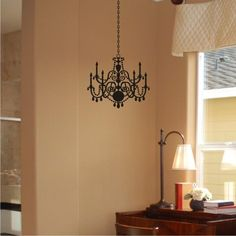 "Chandelier Wall Decal - Cozy Home Wall Decals $24.50 Since the 15th century chandeliers have been a symbol of wealth, status and privilege. Our chandelier vinyl wall decal makes it affordable to have one in every room of your home. Our decal would look lovely in your bedroom or even in the living room. This chandelier wall decal, as shown measures 48"" tall by 15"" wide. The Chandelier alone is 13"" tall by 15"" wide. www.cozyhomewalldecals.com #chandelier #decal, #home_decor"