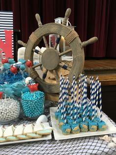 Nautical Candy bar with under the sea marshmallows, steering wheel with blue and white gum balls and pearl chocolate
