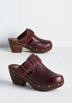 Set current trends into a tailspin by trailblazing a new kind of stride in these burgundy clogs! Fashion blogs will scramble to capture the strut you showcase in the smooth leather uppers, golden grommets, and faux wood heels of these retro slip-ons, earning you status as a pioneer of panache.