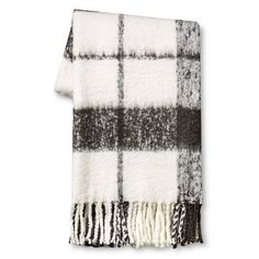 This would be super cute draped over the back of the glider.   Throw Blanket Faux Mohair Plaid Grey/Cream - Threshold™