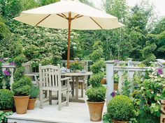 Create a plush patio or deck with container gardens and perimeter plantings that accentuate the space.