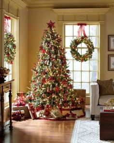 I love the tree and the wreaths hanging inside the beautiful tall windows. It's perfection, isn't it? via