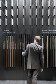 A major materials library, where product samples can be vertically pulled out of a huge wall at the back of the stand, visualizes the products' and materials' variety.