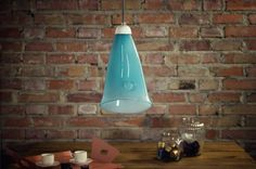 The glass, turquoise pendant lamp fits perfectly into the industrial brick wall. Unusual combination great for your home or flat furnished in a loft style. Product code: LGH0261