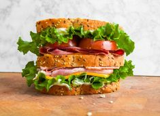 sliced meat, garlic aioli, lettuce, tomato, and freshly sliced cheese. Roasted Garlic Aioli, Gourmet Sandwiches, Meat And Cheese, Lettuce, A Food, Lunch, Fresh, Breakfast, Recipes
