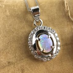 Lab Created White Opal Zircon Halo Sterling Silver Pendant Necklace SD SD9PL350792. Starting at $1