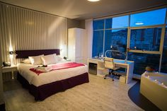 #Stannum's 40 lavishly decorated rooms feature views of the city or the surrounding mountains. Every room comes with feather pillows & duvets, AC and heating, WiFi and speed Internet, Ihome, mini bar, hair dryer and work desk. The picture shows a Junior Suite with 35 m² and Jacuzzi.