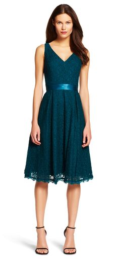 Delicate, scalloped lace covers this party-ready fit and flare dress, finished with a tonal ribbon at waist.