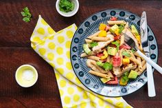 1 box whole wheat penne 1 fresh mango (or 1 1/2 cup pre-cut) 1 avocado Juice of 2 fresh limes 3 cloves garlic, roughly chopped 2 medium tomatoes 1 yellow pepper 1/2 cup fresh cilantro, chopped 1 tsp ground cumin 1 tsp cayenne pepper 2 tbsp olive oil Salt to taste Optional: 1 grilled chicken breast