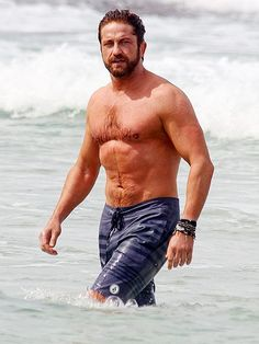 Gerard Butler makes waves while taking a dip at Sydney's Bondi Beach in Australia. http://www.people.com/people/gallery/0,,20801819,00.html#30128213
