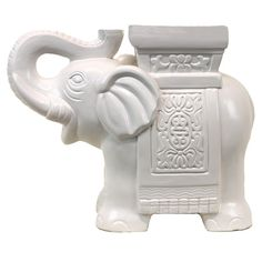 Ceramic elephant statuette in white.          Product: Elephant statuette    Construction Material: Ceramic