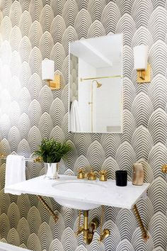 11 ways to luxe up your bathroom, from wallpaper, to shelving, towel details and more: