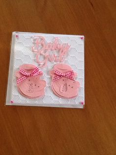 6x6 baby girl card white embossed background with tattered lace booties dies and Tonic wording also a die, comes with insert and envelope.