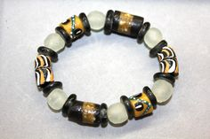 This stretch cord bracelet includes all recycled glass beads made in Ghana, West Africa: black and gold painted beads, clear black spacers and white round translucent beads. All proceeds go to help build the computer lab at SDA School in Ankaase. Size: small (7 inches around.) $20