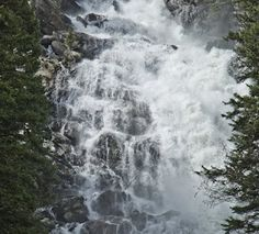 Hidden Falls dropping 300 ft. drop in the Grand Tetons