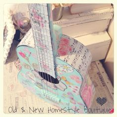 Little girls guitar decoupaged with pretty paper :)