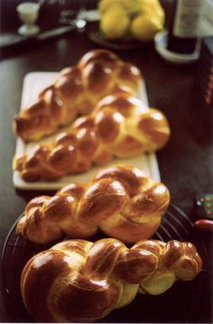 """Zopf or Züpfe is a type of Swiss bread made from white flour, milk, eggs, butter and yeast. The dough is brushed with egg yolk before baking, lending it its golden crust. It is baked in the form of a plait and traditionally eaten on Sunday mornings. A variant from Swabia is known as a Hefekranz (also Hefezopf), and is distinguished from the Swiss Zopf in being sweet. The name """"Zopf"""" is derived from the shape of the bread, and literally means """"braid"""". It is thus similar in appearance to…"""