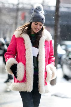Standout in hot pink shearling. #NYFW