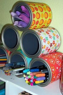 An organizer or pencil cup!  Put some fun paper around each can and you'll have a pretty and functional organizer!