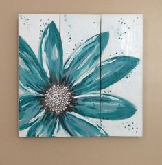 This original flower painting is a turquoise daisy and is hand painted on reclaimed and repurposed wood pallet boards.