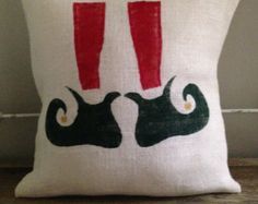 This festive pillow has a forest green Christmas tree silhouette with a gold star tree topper. The Perfect touch for Christmas decorating. Hand painted green on white burlap. Pillow measures 15 x 15 square. Our burlap pillow covers are constructed from all natural jute burlap with envelope closure and come stuffed with a polyfil insert. Each pillow is hand cut from burlap then hand painted with premium acrylic paint…
