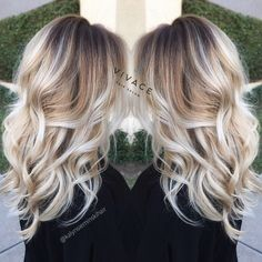 Blonde Balayage Highlights with Curly Long Hair