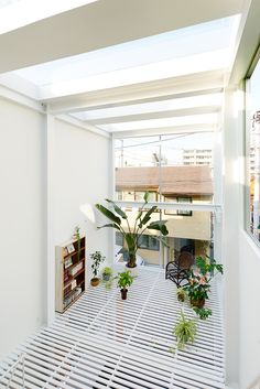 House in Kawasaki by Taichi Mitsuya A dense residential area in the outskirts of Tokio is the emplacement where is constructed House in Kawasaki, based in open spaces, light and the relation with public space, Taichi Mitsuya realized that the neighbours use the street as an extension of the