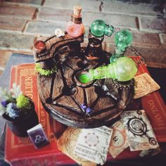 Handmade Skyrim Alchemy Table with Accessories! The table is molded out of clay and stained ad painted to look as realist and woodlike as possible. I recycled glass bottles and painted them with mo...