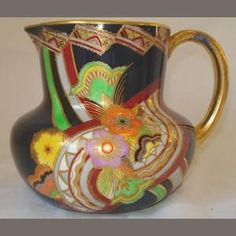 'Carltonware jug, in the 'Rainbow Fan' pattern, on a black ground, with gilt handle' Vintage Pottery, Pottery Art, Painted Vases, Hand Painted, Rainbow Fan, Carlton Ware, Antique Perfume Bottles, China Patterns, Vases Decor