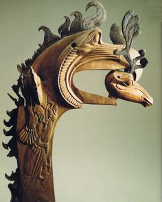 Staff Head in the Form of Large Gryphon's Head with a Deer's Head in its Beak.      Wood and leather; carved. H. 35 cm Pazyryk Culture. 5th century bc.