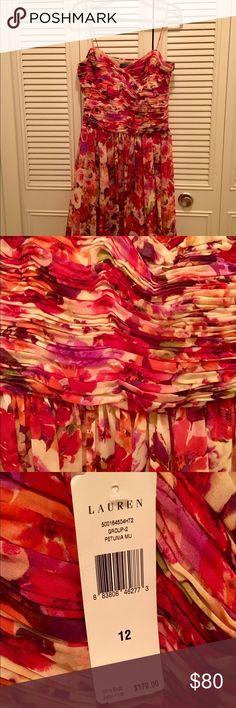 Ralph Lauren floral dress Ralph Lauren knee length floral dress with spaghetti straps. Never worn. Perfect for a wedding. Ralph Lauren Dresses