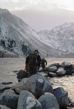 snowcapped mountains frosty forests ice-cold water and wind thrown  against cheeks stiff and red with smiling